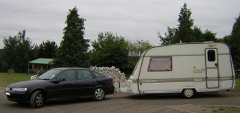 Car towing a caravan - note that the caravan is pretty much level