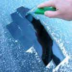 Scraping ice from a car windscreen