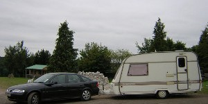 Car towing a caravan