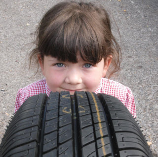 A young school child and a new tyre