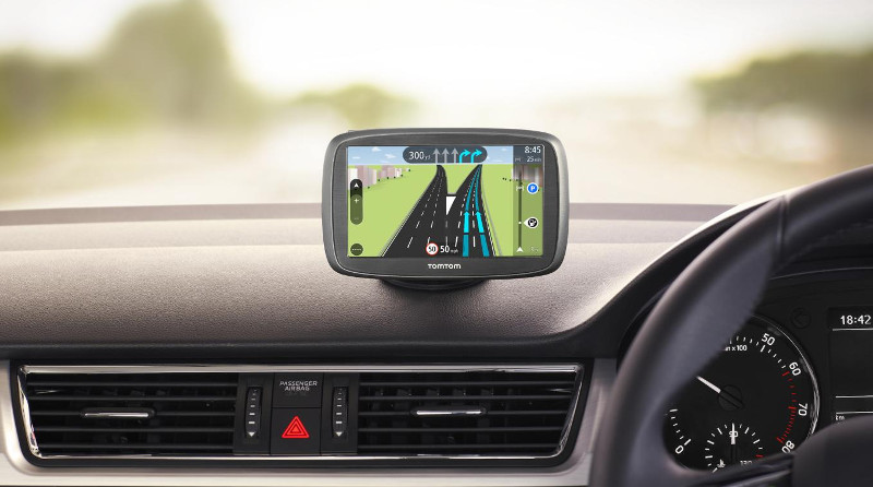 A sat nav mounted on a car dashboard
